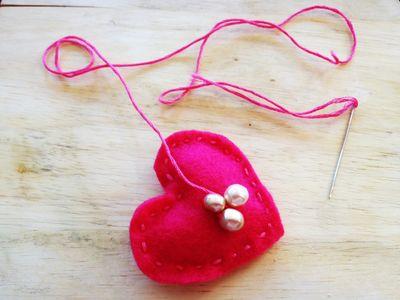 Red felt heart pin by Chris Olson at Momathon